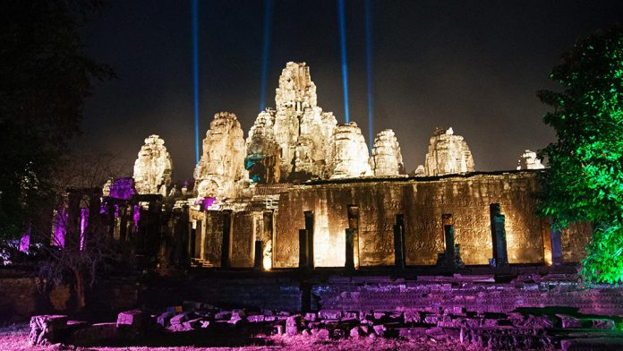 Bayon temple illuminated for Khmer New Year, one of the most important public holidays in Cambodia