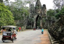 A tuk-tuk entering Angkor Thom on the Small Circuit tour