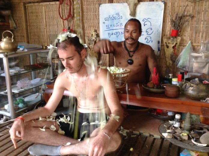Tattoo Master Teven Say performs a Sak Yant blessing ritual