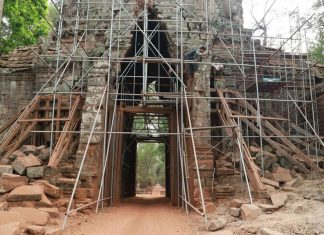 Scaffolding surrounds Angkor Thom's West Gate